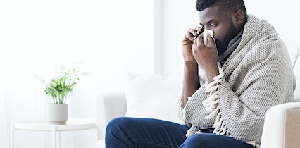 man with symptoms of covid-19 talking with a medhelp telehealth virtual doctor