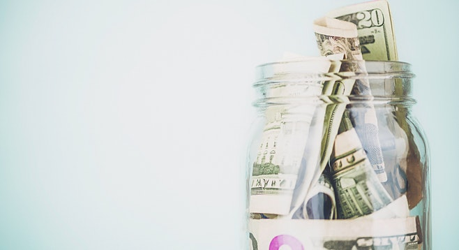 glass jar of cash saved going to urgent care instead of the er