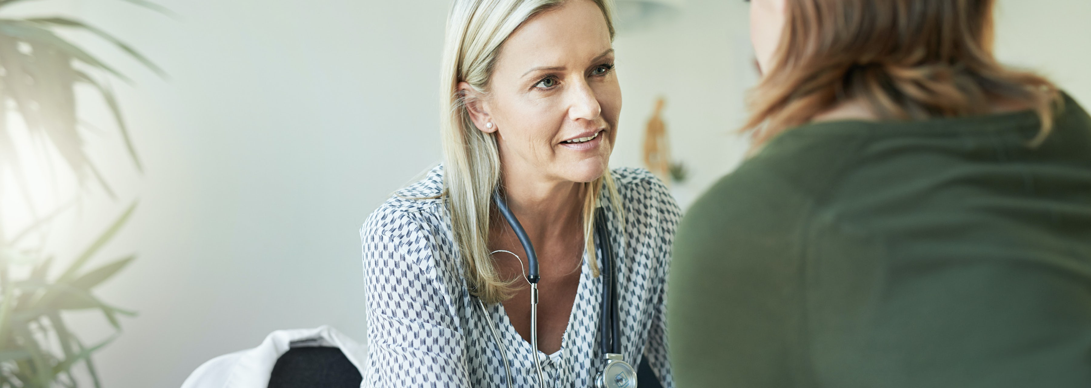 female doctor consulting with female patient about age management and bhrt bioidentical hormone replacement