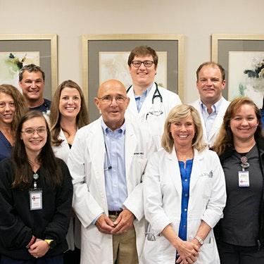 group of smiling doctors and nurses at medhelp birmingham urgent care and primary care