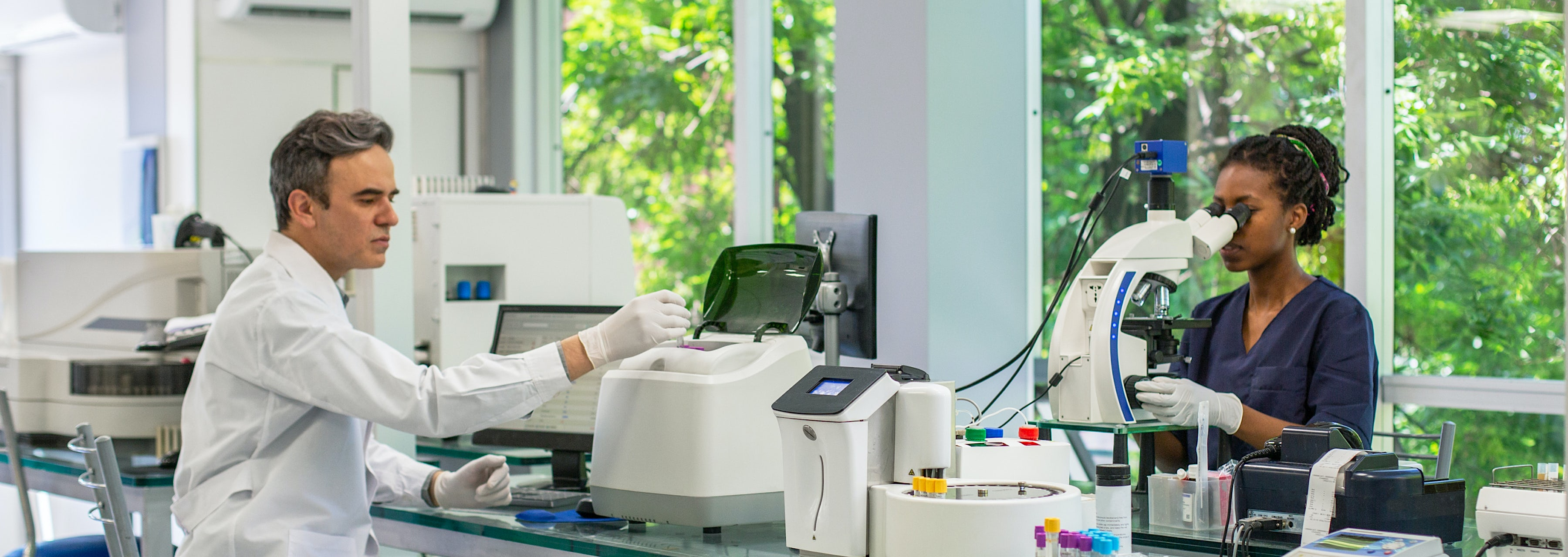 male and female lab technicians conducting clinical trial research cahaba research