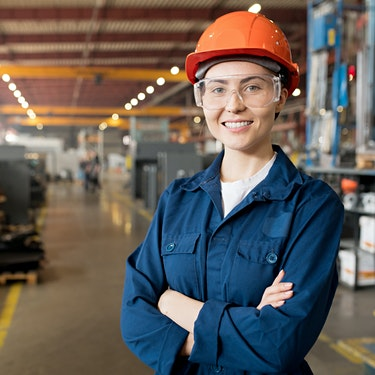 smiling female employee with orange hard hat who uses employee sponsored direct primary care