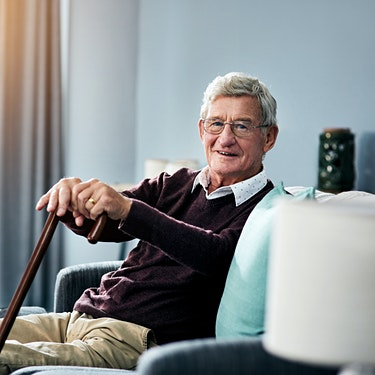 elderly man sitting with cane receiving medicare chronic care management with home monitoring