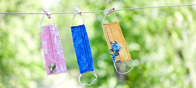 three cloth masks drying on a clothesline protecting from covid-19