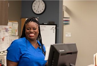 Smiling primary care nurse medhelp